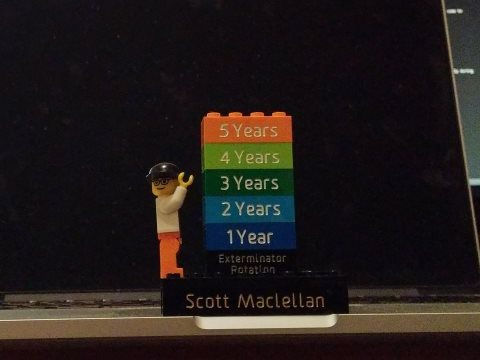 A picture of my desk with a small lego statue celebrating my 5 years at D2L.