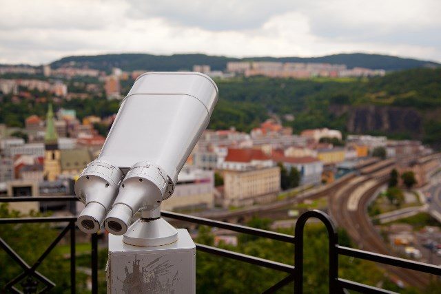 A telescope looking out onto a city.